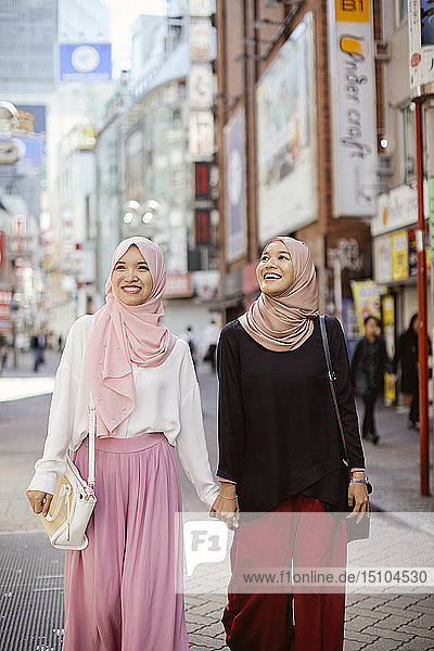 Young South-east Asian women enjoying sightseeing in Tokyo