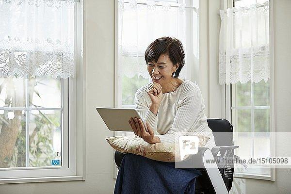 Japanese senior woman on electric wheelchair