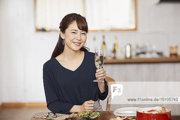 Japanese woman having home party