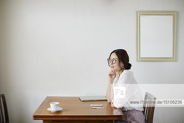 Japanese woman working at a cafe