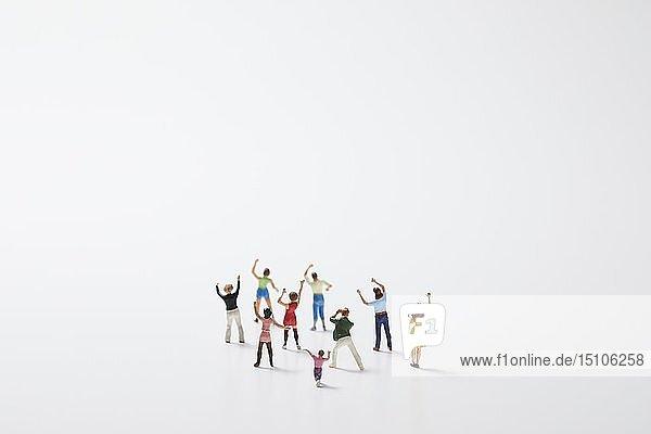 Miniature figures cheering