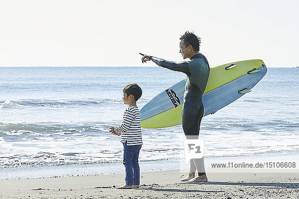 Japanese kid with father at the beach