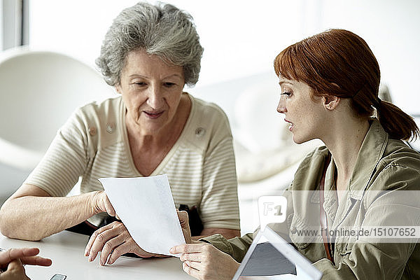 Mother and daughter reading prescription