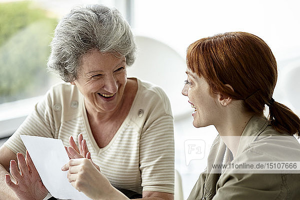 Mother and daughter holding prescription