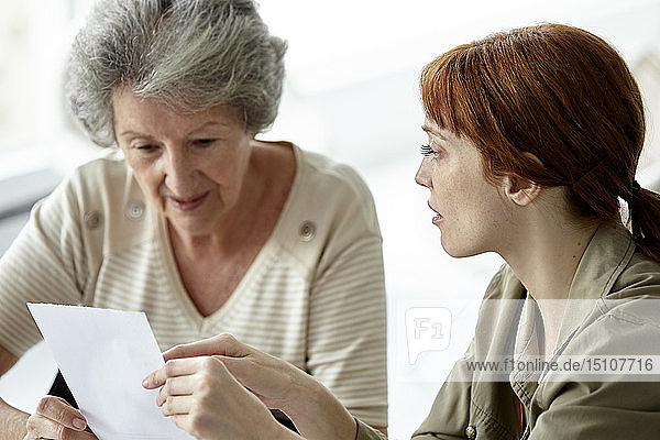 Mother and daughter discussing over prescription