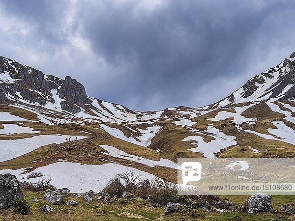 Spain  Asturias  Tuiza de Arriba  Cantabrian Mountains  people on their way to Pena Ubina
