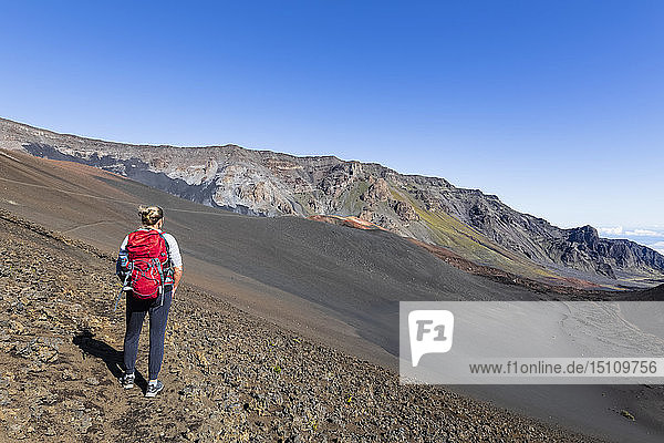 Tourist enjoying view from Sliding Sands Trail  Haleakala volcano  Haleakala National Park  Maui  Hawaii  USA
