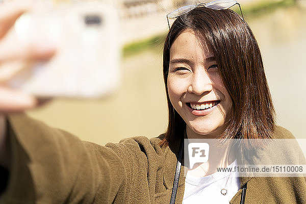 Happy young woman taking a selfie
