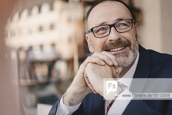 Portrait of smiling mature businessman in a cafe