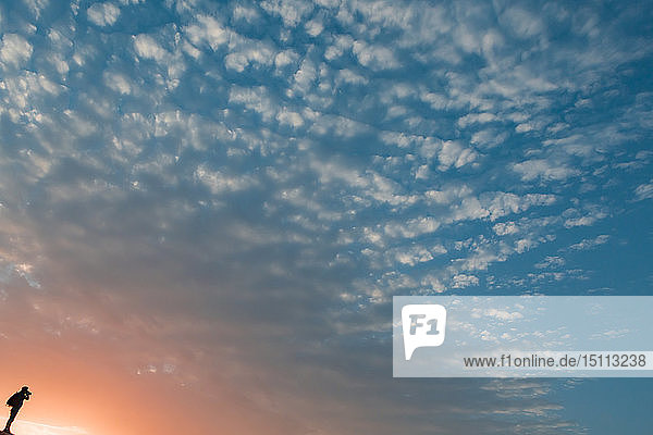 Man taking pictures at sunset,  Oman
