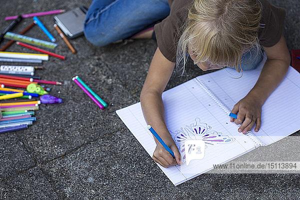 Girl crouching on pavement painting