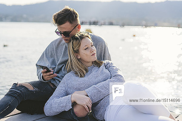 Young couple relaxing on jetty at Lake Zurich  Zurich  Switzerland