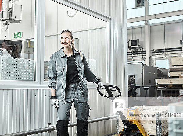 Industry  woman using pallet jack