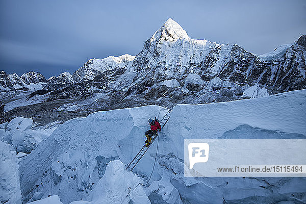 Nepal  Solo Khumbu  Mountaineer at Everest Icefall  Pumori in background
