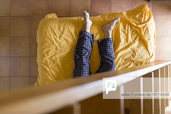 Man lying on bed  wooden ladder