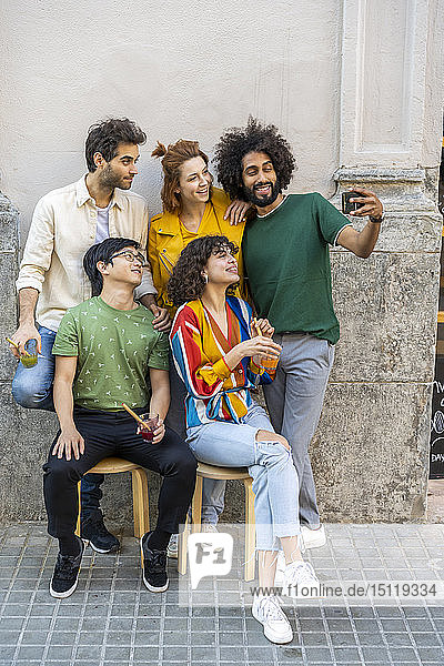 Man taking a selfie with friends in the city