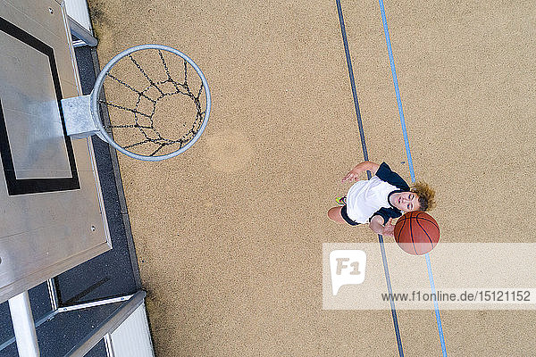 Young woman playing basketball,  top view
