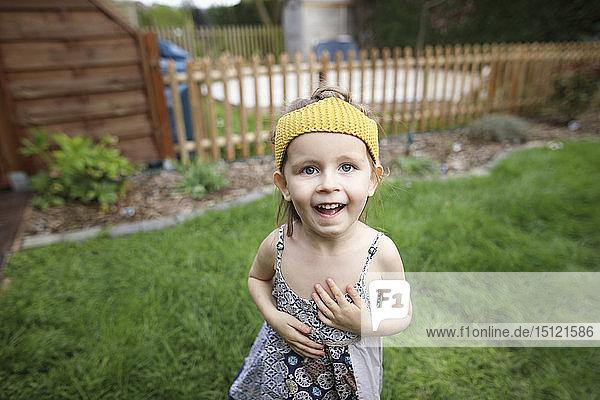 Portrait of happy girl in garden