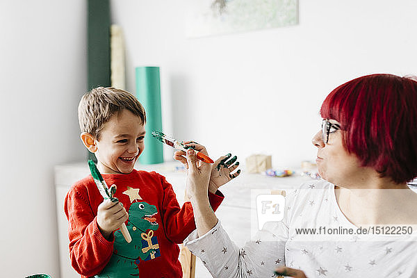 Mother and son having fun while doing crafts at home