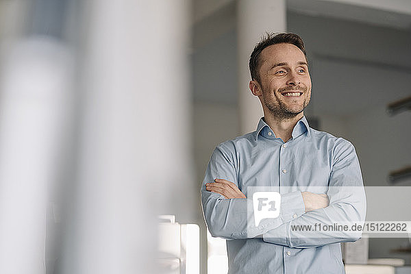 Portrait of a successful businessman  smiling with arms crossed