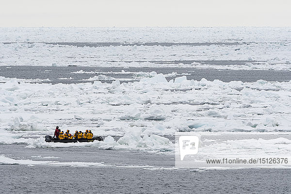 Tourists on inflatable boats exploring the Polar Ice Cap  81 degrees  north of Spitsbergen  Svalbard  Arctic  Norway  Europe