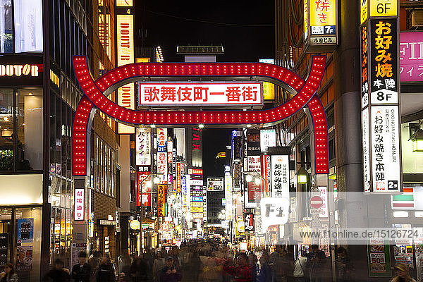 A neon red gate (torii) and neon signs in the Kabukicho district  centre of nightlife and entertainment in Tokyo  Honshu  Japan  Asia