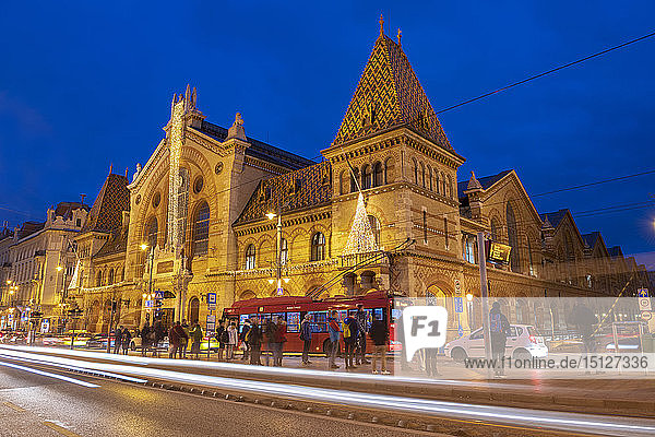 Exterior of Great Market Hall (Central Market Hall) at night with light trails  Kozponti Vasarcsarnok  Budapest  Hungary  Europe