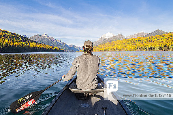 Canoeing across Bowman Lake  Glacier National Park  Montana  United States of America  North America