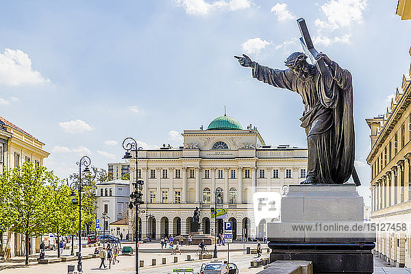 A statue and the Polish Academy of Sciences in the background  Old Town  UNESCO World Heritage Site  Warsaw  Poland  Europe