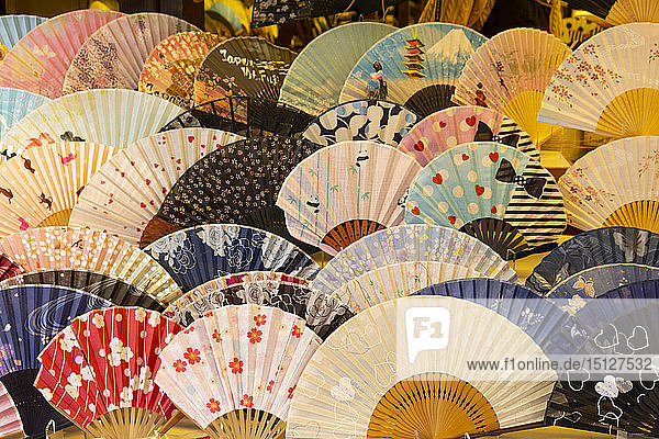 Colourful Japanese fans for sale at a souvenir shop in Kyoto  Japan  Asia