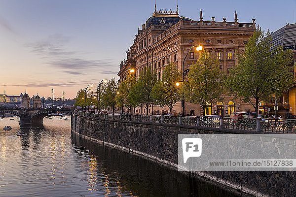 The National Theatre (Narodni divadlo) seen from the banks of Vltava River at dusk  Prague  Bohemia  Czech Republic  Europe
