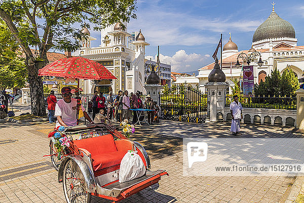 A local rickshaw (tuk tuk) outside Kapitan Keling Mosque  in George Town  Penang Island  Malaysia  Southeast Asia  Asia