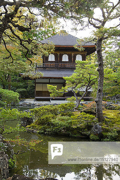 The Silver Pavilion reflected in a pond surrounded by pine trees at the Ginkaku-ji Pure Land Garden  Kyoto  Japan  Asia