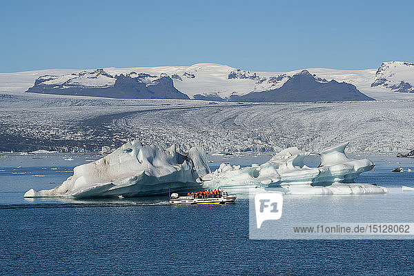 Jokulsarlon Glacier Lagoon with boat tour  with Breidamerkurjokull Glacier behind  South East Iceland  Iceland  Polar Regions