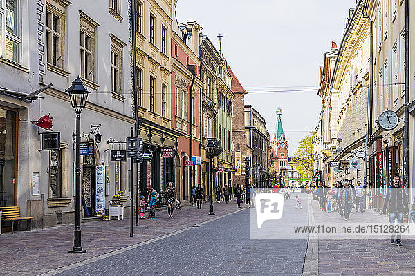 A street scene in the medieval old town  UNESCO World Heritage Site  Krakow  Poland  Europe
