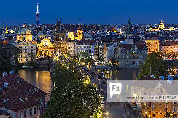 View from the Mala Strana Bridge Tower over Charles Bridge and the old town at dusk  UNESCO World Heritage Site  Prague  Bohemia  Czech Republic  Europe