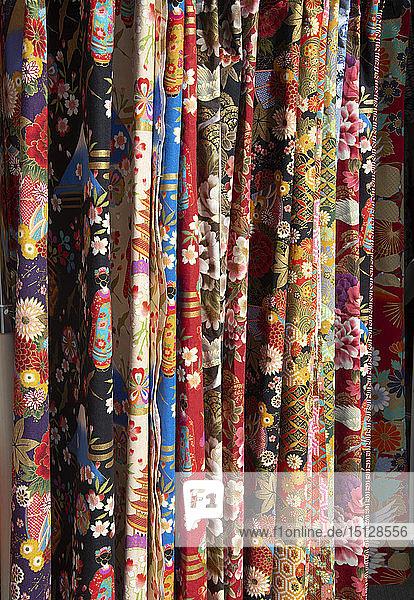 Colourful Japanese fabrics for sale at the Hida Takayama Miyagawa morning market in Takayama  Japan  Asia