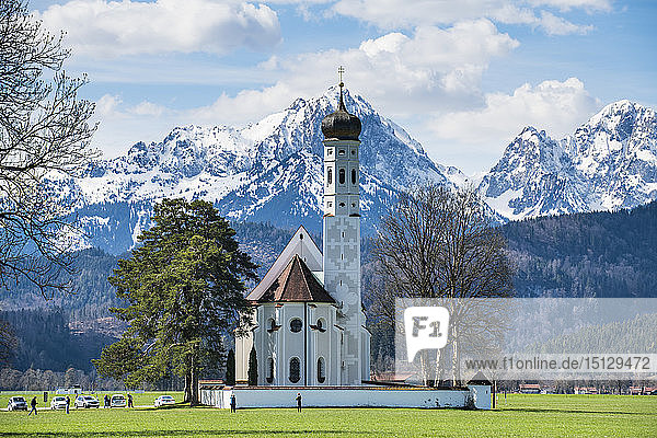 Catholic Church of St. Coloman with the Alps behind  Schwangau  Bavaria  Germany  Europe