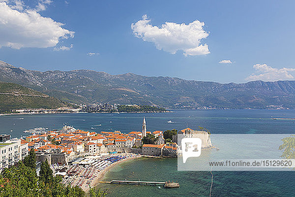 View over crowded beach to the Old Town (Stari Grad)  and Budva Bay  Budva  Montenegro  Europe