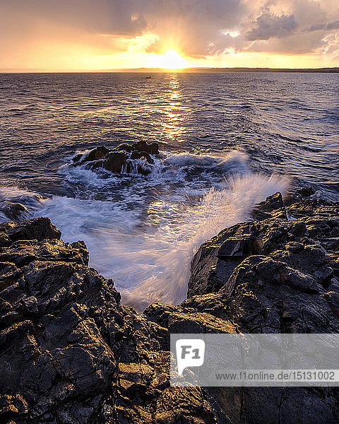 Sunrise across the bay towards Godrevy and Gwithian  St. Ives  Cornwall  England  United Kingdom  Europe