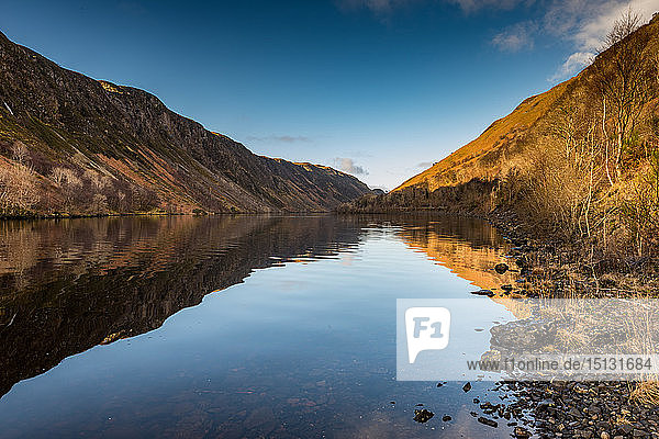 Early morning sunlight hits the waters of Loch Awe  Highlands  Scotland  United Kingdom  Europe
