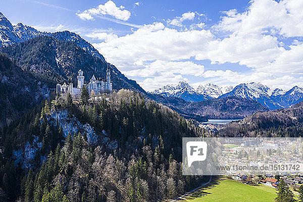 Aerial of Castle Neuschwanstein  with the Alps behind  Schwangau  Bavaria  Germany  Europe