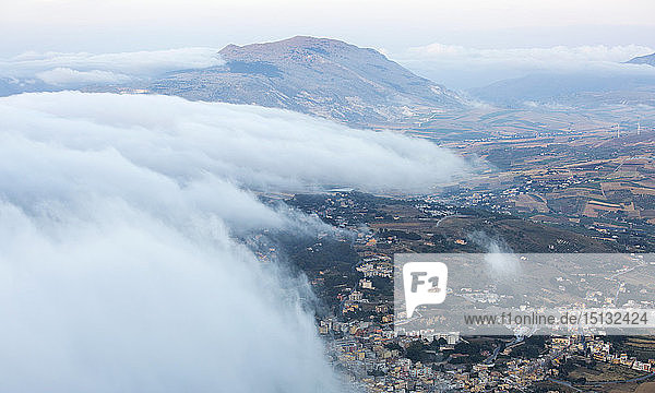 View over surrounding landscape from the city walls  clouds drifting across valley  Erice  Trapani  Sicily  Italy  Mediterranean  Europe