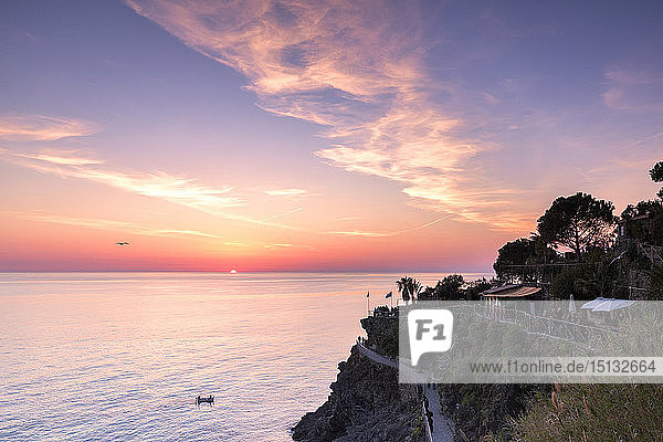Sunset on the sea above the panoramic footpath of Manarola  Cinque Terre  UNESCO World Heritage Site  Liguria  Italy  Europe
