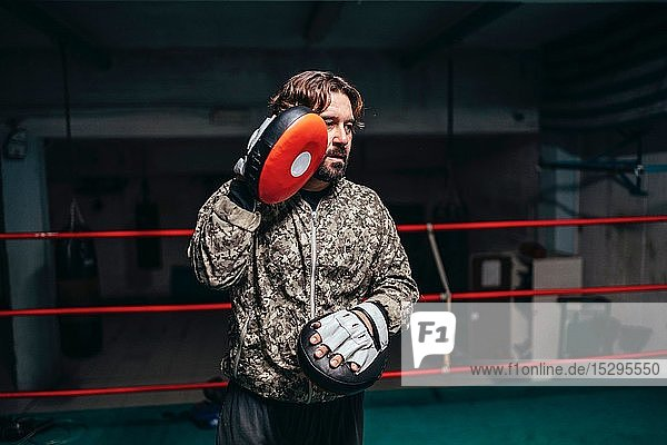 Trainer in boxing ring