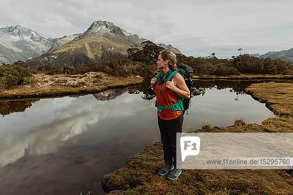 Hiker enjoying scenic lake view  Queenstown  Canterbury  New Zealand