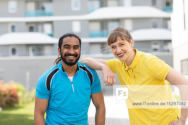 Multi-ethnic couple taking break after exercise