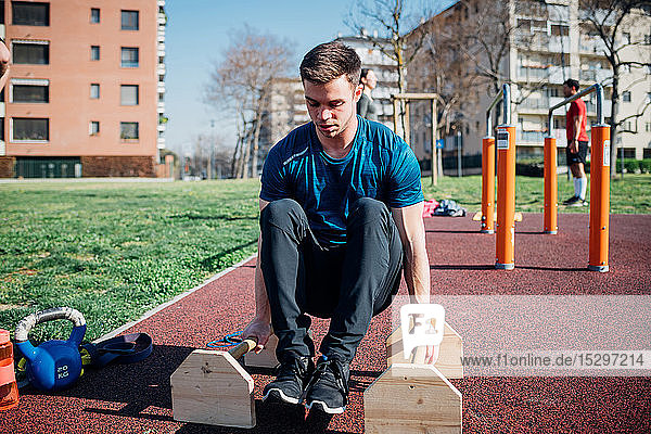 Calisthenics at outdoor gym  young man doing push ups