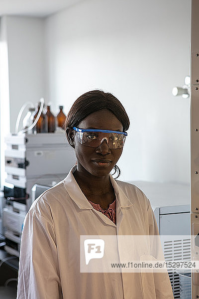 Young female scientist wearing safety glasses in laboratory  portrait