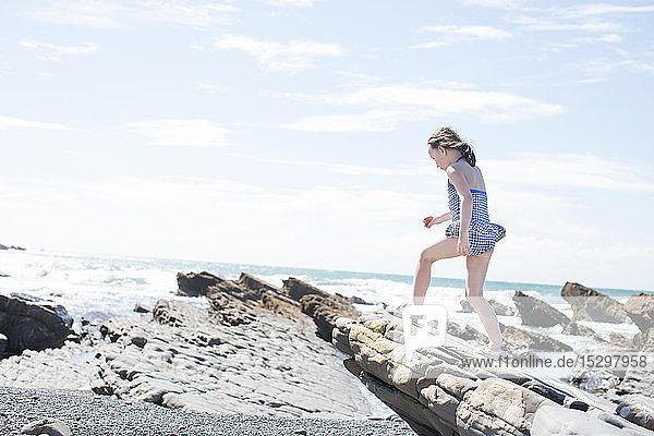 Girl exploring beach